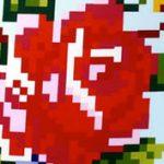 Napi textil: pixeles rózsa a díszpárnán